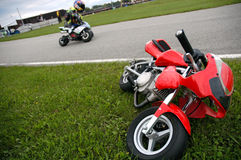 Minibike. Little accident on minibikes races Stock Image