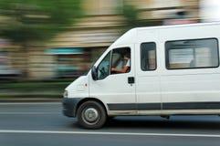 Minibus commovente Immagini Stock