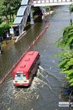 Minibus in flood Stock Photo