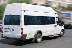 Minibus goes on the city street Stock Image