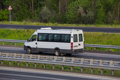 Minibus goes on the country highway Royalty Free Stock Photography
