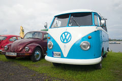 Minibus Volkswagen T1 Kombi 1950-ies and Volkswagen Beetle on the festival of retro cars in Kronstadt Royalty Free Stock Photography