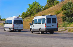 Minibuses go on the twisting road Royalty Free Stock Photo