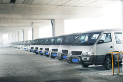 Minibuses  line. Row of school minibuses  in a car park Stock Photography