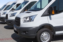 Minibuses and vans outside Royalty Free Stock Images