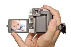 MiniDv Kamera in den Mannhänden Lizenzfreies Stockbild