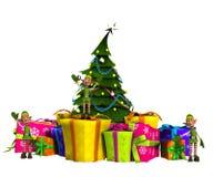 Minielfe auf Geschenken mit Weihnachtsbaum Stockfotos