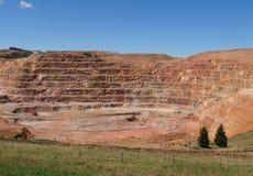 Miniera d'oro di V e di cc immagine stock