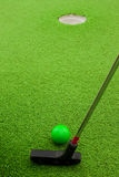 Minigolf. A mini-golf ball and putter setup for a shot Royalty Free Stock Image
