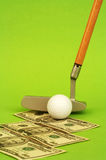 Minigolf. And dollars Stock Images