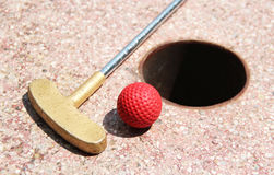 Minigolf ball on a course. Golf club in small German village Stock Image