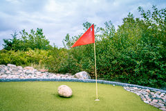 Minigolf cource. Large minigolf cource with a flag in the hole Stock Images