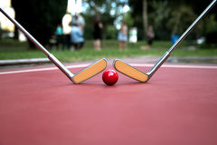 Free Minigolf Iron Rackets And A Red Ball At A Court Ground. Royalty Free Stock Photography - 77106167