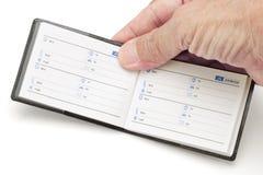miniholding för adressbokhand Fotografering för Bildbyråer