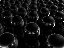 Minimal Black Spheres. Abstract conceptual composition of a 3D chrome spheres on a reflective surface in black background Stock Image