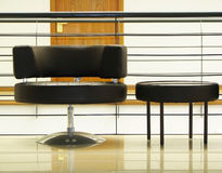 Minimal chair. A black modern chair in the lobby Royalty Free Stock Photos