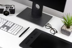 Minimal clear white workspace stock photography