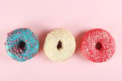 Minimal composition in vibrant colors with bright glaze donuts royalty free stock image