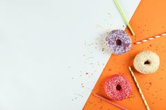 Minimal composition in vibrant colors with bright glaze donuts stock photos