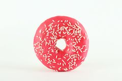 Minimal composition in vibrant colors with bright glaze donuts royalty free stock photography