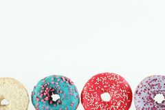 Minimal composition in vibrant colors with bright glaze donuts stock image