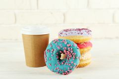 Minimal composition in vibrant colors with bright glaze donuts stock photography