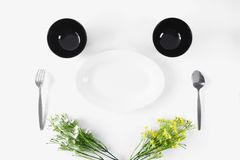 Simple cutlery set on white background. Minimal cutlery set on white background. Top view Stock Photos