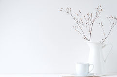 Minimal elegant composition with coffee cup and white vase royalty free stock photography