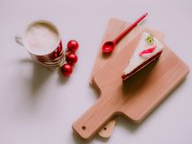Minimal flat lay concept for christmas and new year event by cof. Fee cup ,gift box and white cake on wooden chopping board arrange on table with  background Royalty Free Stock Image