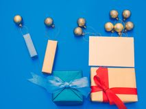 Minimal flat lay style by balloon flew away concept for christmas and new year event with present box , greeting card and group o. F shiny gold ball or balloon stock photos