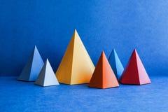 Minimal geometric still life background. Platonic solid geometric figures. Three-dimensional pyramid rectangular stock image