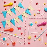 Minimal happy birthday decor for party. Sweet candy, balloons, straw.  stock photography
