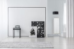 Minimal living room interior. Black and white painting in minimal living room interior with grey carpet and mirror Stock Images