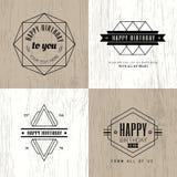 Minimal monochrome geometric vintage happy birthday badge on woo. Den background Royalty Free Stock Photos