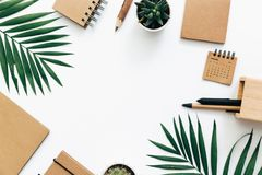 Minimal Office desk table with stationery set, supplies and palm leaves. stock images