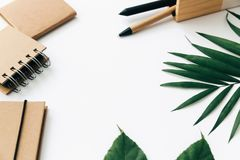 Free Minimal Office Desk Table With Stationery Set, Supplies And Palm Leaves. Royalty Free Stock Photo - 111057015