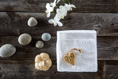 Minimal pampering concept on rustic old wood background, flat lay stock photo