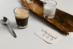 Minimal refreshment break for two. Iced coffee and milk cup. On table, space for text Stock Photography