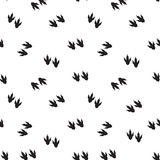 Minimal seamless pattern with dinosaur foots. Black and white colors Stock Photo