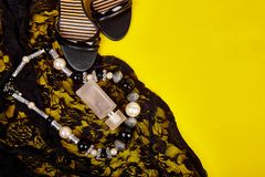 Minimal set of women accessories yellow background stock photo