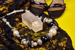 Minimal set of women accessories yellow background stock image