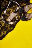 Minimal set of women accessories yellow background stock photos