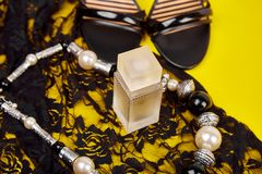 Minimal set of women accessories yellow background royalty free stock photos