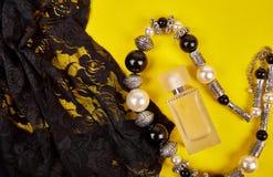 Minimal set of women accessories yellow background royalty free stock photo