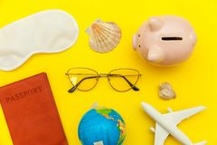 Minimal simple flat lay travel adventure trip concept on yellow colourful trendy modern background. Vacation travel adventure trip concept. Minimal simple flat stock photography