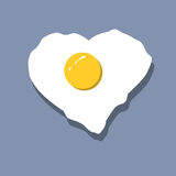 Fried egg heart shaped vector on blue background. Minimal style design of heart shape fried egg  on blue background Stock Photos