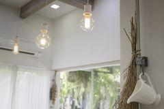Minimal style interior decorated with vintage light bulbs. Stock photo Royalty Free Stock Photography