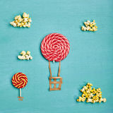 Minimal Travel Fun Concept. Creative Travel Concept - Top View Sweet Red Candy Air Balloons and Popcorn Clouds on Blue Background. Minimal Travel and Food Fun royalty free stock photo