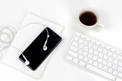 Minimal white bussiness workspace with cup of espresso stock photo