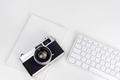 Minimal white workspace with vintage camera stock images